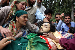 September 11, 2017 - Kulgam, Jammu and Kashmir, India - (EDITORS NOTE: Image depicts death) Back to back four funerals to a slain Rebel Sayar Ah Wani in Wanpora village in Kulgam south of Kashmir on Monday, 11 September 2017. Thousands attend last rites of slain militant. Two militants were killed and one OGW was arrested during gun fight with forces in Kulgam. (Credit Image: © Muneeb Ul Islam/Pacific Press via ZUMA Wire)