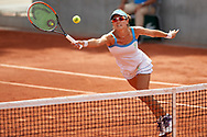 Paris, France - 2017 May 31: Alicja Rosolska from Poland plays a forehand while her women's double match first round during tennis Grand Slam tournament The French Open 2017 (also called Roland Garros) at Stade Roland Garros on May 31, 2017 in Paris, France.<br /> <br /> Mandatory credit:<br /> Photo by © Adam Nurkiewicz<br /> <br /> Adam Nurkiewicz declares that he has no rights to the image of people at the photographs of his authorship.<br /> <br /> Picture also available in RAW (NEF) or TIFF format on special request.<br /> <br /> Any editorial, commercial or promotional use requires written permission from the author of image.