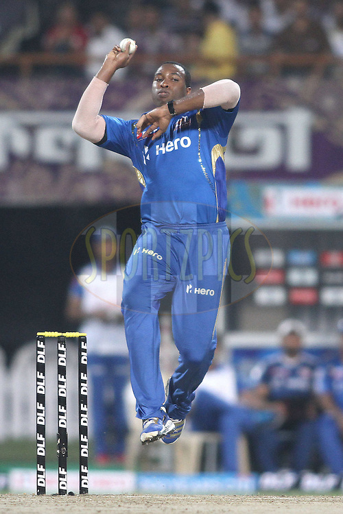 Kieron Pollard of the Mumbai Indians sends down a delivery during match 58 of the the Indian Premier League (IPL) 2012  between The Kolkata Knight Riders and The Mumbai Indians held at the Eden Gardens Stadium in Kolkata on the 12th May 2012..Photo by Shaun Roy/IPL/SPORTZPICS
