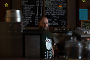 Morgan Grover, roaster and manager at Bell's Country Coffee in Elmira, New York on Thursday, May 25, 2017. Bell's opened a location at Arnot Mall, but business was poor and it closed in January. CREDIT: Mike Bradley for the Wall Street Journal<br /> RIPPLES