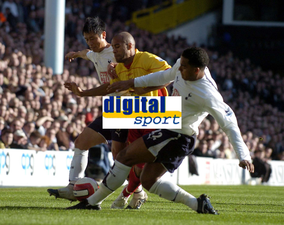 Photo: Olly Greenwood.<br />Tottenham Hotspur v Watford. The Barclays Premiership. 17/03/2007. Tottenham's Tom Huddlestone and Young-Pyo Lee tackle Watford's James Chambers