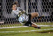 BYU goalkeeper Erica Owens makes a penalty kick save during the Women's Soccer Sweet 16 match between BYU and Marquette University at BYU,Saturday, Nov. 17, 2012.