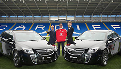 CARDIFF, WALES - Wednesday, January 12, 2011: Wales' manager Gary Speed (C) with Chief-Executive Jonathan Ford (L) and Vauxhall Managing Director Duncan Aldred photographed next to Vauxhall cars during the announcement that British car manufacturer Vauxhall is to become the official leading sponsorship partner to the Wales international football teams, at Cardiff City Stadium. (Pic by: David Rawcliffe/Propaganda)