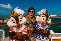 Passenger with Chip and Dale (Disney characters) aboard the Disney Dream cruise ship sailing between Florida and the Bahamas.