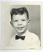 identity style portrait photo of happy smiling young boy
