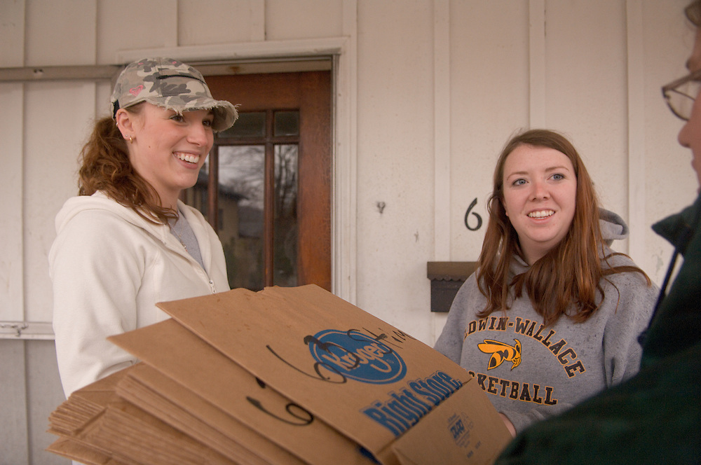 Meg Alexander(hat),Jen Toole(OU green jacket), and Amelia Hogan(grey sweater)...11.8.06...Off-campus Ohio University students to help community members in need..ATHENS, Ohio (Nov. 8, 2006) - Ohio University students living off-campus will have the opportunity to empty their cupboards and pantries for a good cause when the Off-Campus Community Assistants will collect non-perishable food items from student residents and community members living in the off-campus community Wednesday, Nov. 15. The food items will be donated to the Athens Food Pantry. ..?This project was conceptualized and organized by students and has the potential to be one of the largest community service projects accomplished at Ohio University,? said Kevin Smith, graduate assistant for Off-Campus Living. ?Best of all, this project will benefit the Athens Food Pantry and those people whom the food pantry seek to assist.?..The Community Assistant program is now in its second year at Ohio University and consists of 15 undergraduate students who live throughout the off-campus area. These students serve as peer educators, liaisons between the students and the university, as well as information providers and potential problem-solvers for off-campus students who otherwise have no direct outlet for their concerns. ..?This is a chance for off-campus students to show Athens residents that we truly care about our community? said Community Assistant Student Coordinator Meg Alexander. ..On Nov. 15, each street's community assistant will go door-to-door distributing paper grocery bags to collect any non-perishable food items. Additionally, students may plan ahead and register their contribution and/or their assistance in the collection process at: www.ohio.edu/offcampus/fooddrive.cfm...A total of $400 in prizes will be awarded to those students who donate the most non-perishable food items. ..This community-building project is being sponsored in part by Off-Campus Living and CampusMenus.com with assistance from S