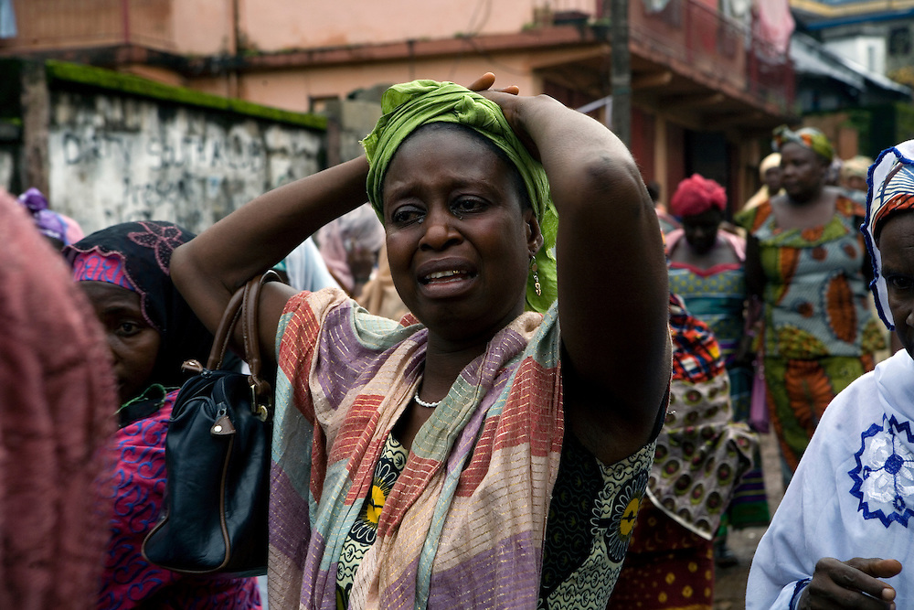 Mommy's aunty Agnes Vanguahun cries as Mommy's body is taken away. ..Mommy delivered and died from postpartum bleeding at the PCMH (Princess Christian Memorial Hospital). Freetown, Sierra leone.