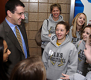 UD Women's basketball head coach Jim Jabir (left) talks to a group of girls including Danielle Orick (center,) 13, from Centerville before the game at the University of Dayton Arena, January 21, 2007.  The originally scheduled National Girls and Women in Sports Day activities were postponed because of the weather, but some of the girls that stayed for the game were given a behind the scenes tour of the facilities.