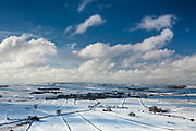 Snow covered fields pattern the landscape around Foolow village in March. Peak District, Derbyshire, England, UK