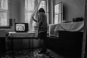 A woman in her flat in Prague Zizkov.