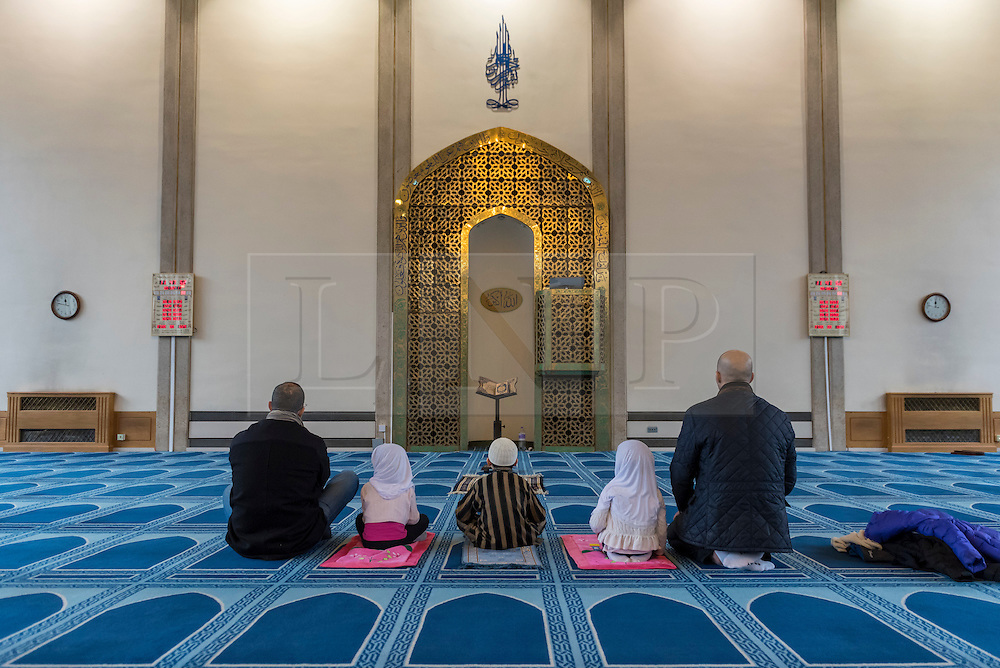 © Licensed to London News Pictures. 05/02/2017. London, UK. Men and young children pray during an open day held at the Central London Mosque near Regent's Park.  Over 150 mosques across the UK have been encouraged to hold mosque open days as part of Visit My Mosque Day, a national initiative facilitated by the Muslim Council of Britain (MCB), showcasing how mosques are not only spiritual focal points, but also servants to their localities helping people of all faiths and none by running food banks, feed-the-homeless projects, neighbourhood street cleans, local fundraising and more. Photo credit : Stephen Chung/LNP
