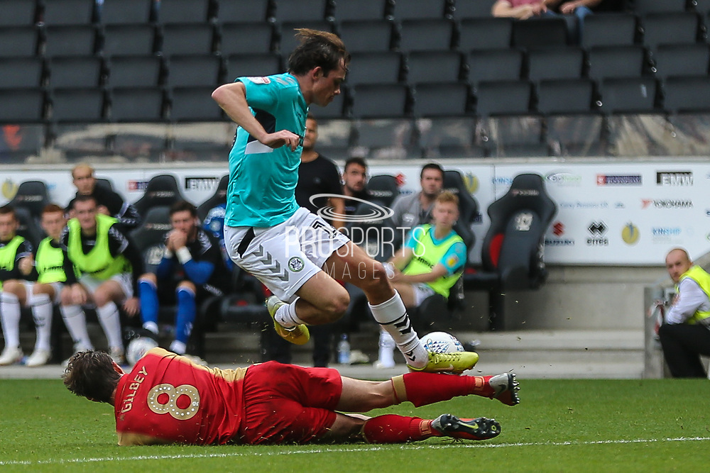 Forest Green Rovers Theo Archibald(18) is tackled by Milton Keynes Dons Alex Gilbey(8) during the EFL Sky Bet League 2 match between Milton Keynes Dons and Forest Green Rovers at stadium:mk, Milton Keynes, England on 15 September 2018.