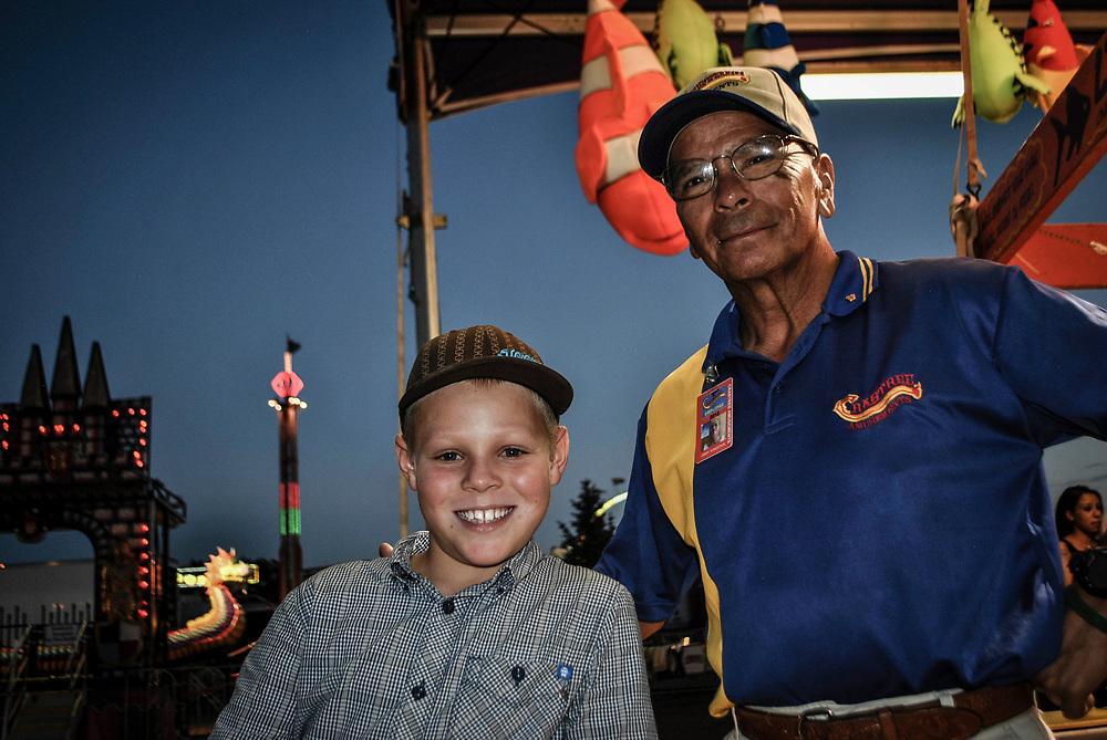 A boy and a vendor having fun at the Colorado State Fair in Pueblo, Colorado.