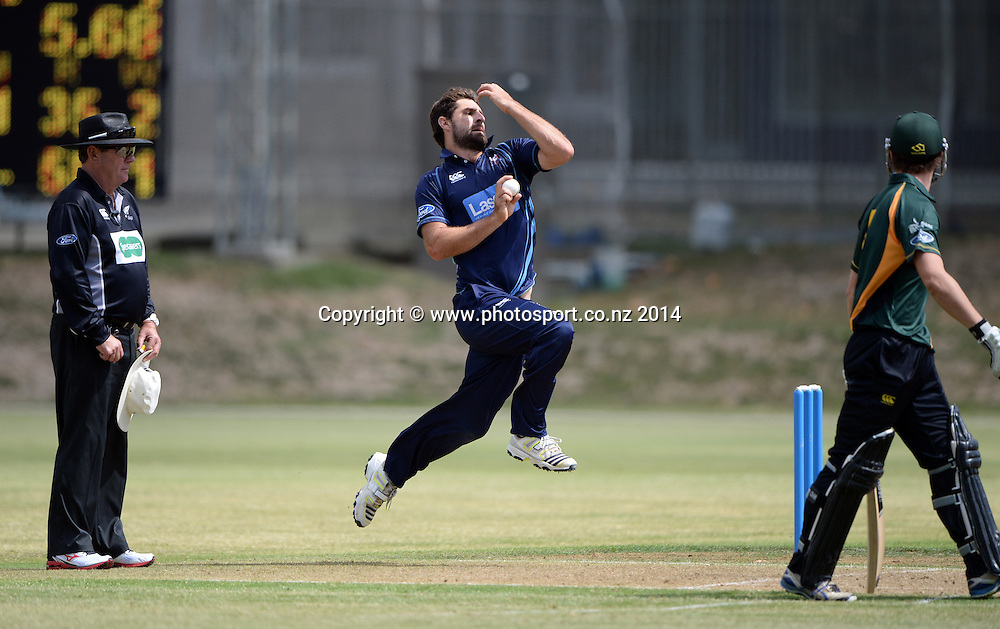 Colin de Grandhomme bowling during the Ford Trophy 50 over One Day match between the Auckland Aces and Central Stags. Eden Park Outer Oval, Auckland on Wednesday 12 March 2014. Photo: Andrew Cornaga / www.Photosport.co.nz