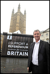 Nigel Evans pose's  for a photograph in front of a Ballot box with a I Support A  Referendum for Britain slogan on it in Westminster, London, United Kingdom. Wednesday, 6th November 2013. Picture by Andrew Parsons / i-Images