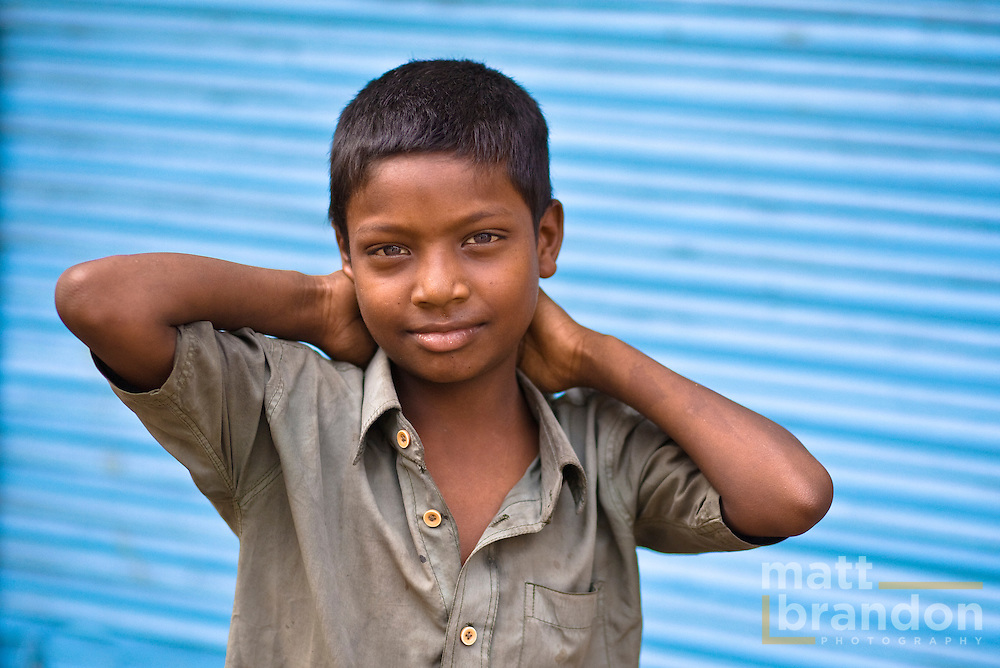 A young boy in the streets of old Delhi.