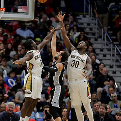 Nov 19, 2018; New Orleans, LA, USA; New Orleans Pelicans guard Jrue Holiday (11) and forward Julius Randle (30) defend against San Antonio Spurs guard Marco Belinelli (18) during the second quarter at the Smoothie King Center. Mandatory Credit: Derick E. Hingle-USA TODAY Sports