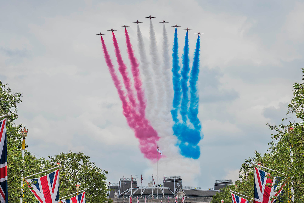 The flypast over the mall was finished by the Red Arrows - Queens 90th birthday was celebrated by the traditional Trooping the Colour as well as a flotilla on the river Thames.