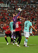 Manchester United's David De Gea punches clear from a corner during an International Champions Cup game won by Manchester United 1-0 during, Saturday, July 20, 2019, in Singapore. (Kim Teo/Image of Sport)