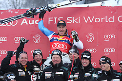 KITZBUHEL AUSTRIA. 22-01-2011. Didier Cuche (SUI) the race winner and his team at the presentation ceremony for the 71st Hahnenkamm downhill race part of  Audi FIS World Cup races in Kitzbuhel Austria.  Mandatory credit: Mitchell Gunn