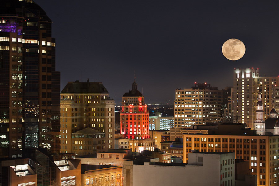 Looking east at a full moon into downtown Sacramento from the rooftop vantage of a undisclosed location on Capitol Mall.