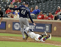 September 12, 2017 - Arlington, TX, USA - The Texas Rangers' Delino DeShields beats the throw to first base as Seattle Mariners relief pitcher Casey Lawrence (61) can't make the tag during the ninth inning at Globe Life Park in Arlington, Texas, on Tuesday, Sept. 12, 2017. The Mariners won, 10-3. (Credit Image: © Max Faulkner/TNS via ZUMA Wire)