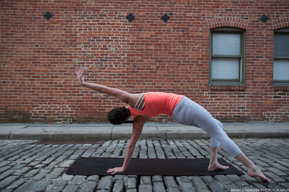 May 16, 2016; Baltimore, MD, USA; lululemon ambassador Ciara Desmond performs yoga movements in Federal Hill/Otterbien, Inner Harbor Promenade and core power yoga for lululemon athletica Harbor East.<br /> <br /> Credit:<br /> Brian Schneider-www.ebrianschneider.com<br /> Instagram - @ebrianschneider<br /> Twitter - @brian_schneider<br /> Facebook - @ebrianschneider