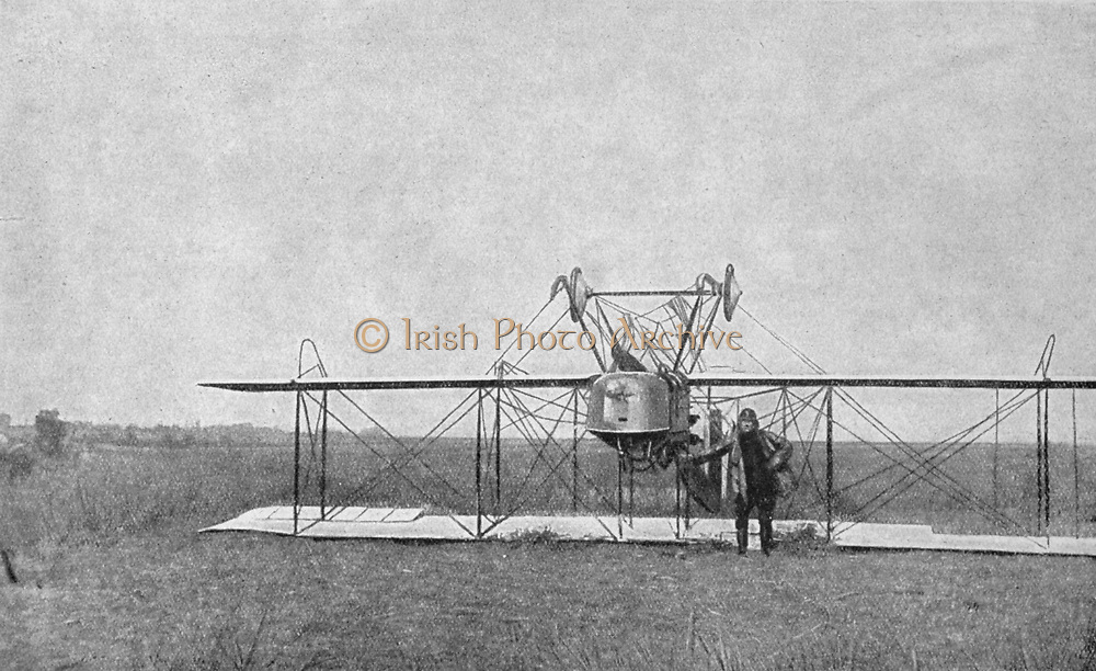 World War I 1914-1918: French aviator who has crashed on a reconnaissance mission, standing beside his biplane which has landed upside down. From 'Le Pays de France', Paris, 23 September 1915. Flying, Aviation