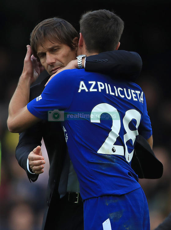 Chelsea manager Antonio Conte embraces Chelsea's Cesar Azpilicueta after the final whistle