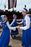 Young girls dressed in Norwegian costume dancing outside Sons of Norway Hall, Petersburg, southeast Alaska, USA