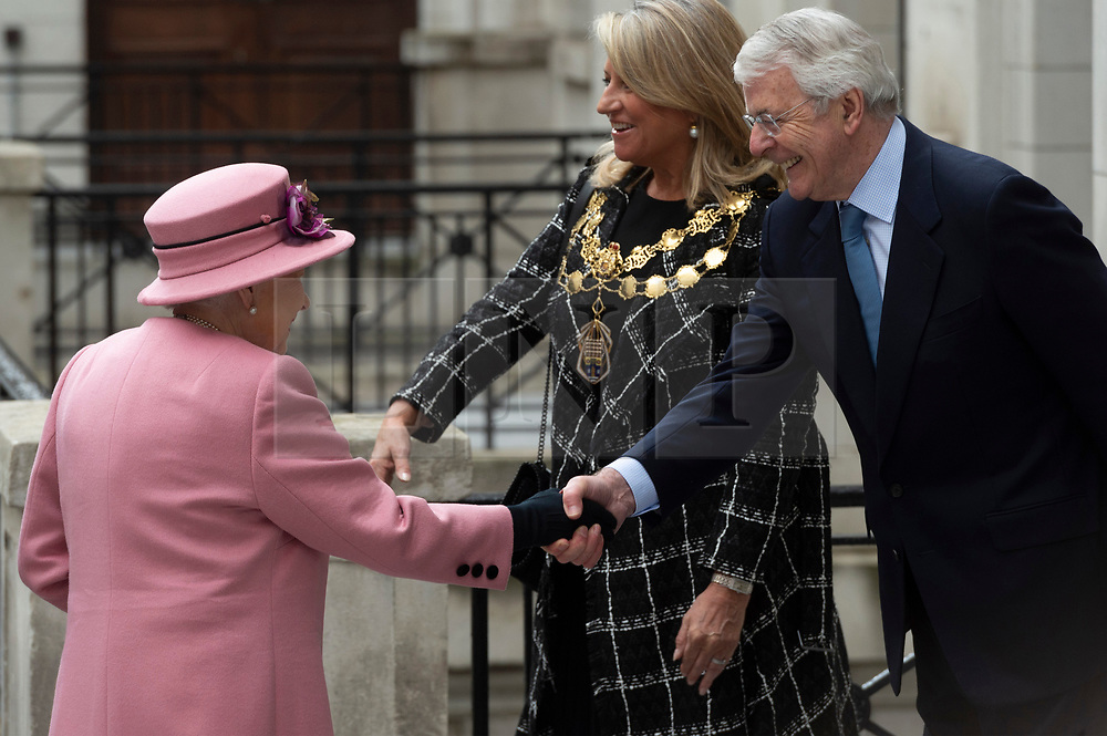© Licensed to London News Pictures. 19/03/2019. London, UK. Queen Elizabeth II  meets with former British Prime Minister John Major during a visit to King's College to open Bush House, the latest education and learning facilities on the Strand Campus. Photo credit: Ray Tang/LNP