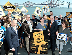 In front of the iconic Forth Rail Bridge, Liberal Democrat leader Vince Cable, former Change UK lead candidate David MacDonald, Lib Dem European election candidates and party activists unveiled a new election poster calling on Remain voters to unite to stop Brexit.<br /> <br /> Pictured: EU candidate Sheila Ritchie, Sir Vince Cable MP, David MacDonald, Christine Jardine MP and Alex Cole-Hamilton MSP<br /> <br /> Alex Todd | Edinburgh Elite media