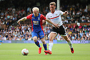 Crystal Palace midfielder, Jonathan Williams (20) holding off Fulham midfielder and captain, Scott Parker (08) during the Pre-Season Friendly match between Fulham and Crystal Palace at Craven Cottage, London, England on 30 July 2016. Photo by Matthew Redman.