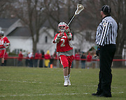Kyle Landrigan of Canandaigua passes to a teammate during a game against Pittsford on Saturday, April 11, 2015.