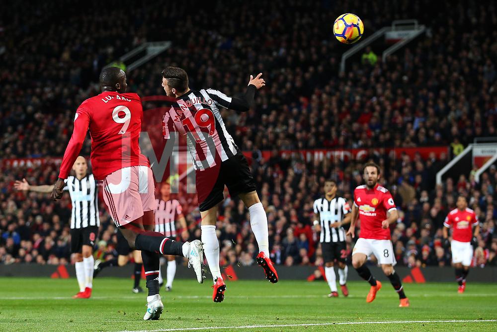 Romelu Lukaku of Manchester United fires a header at goal under pressure from Javi Manquillo of Newcastle United - Mandatory by-line: Matt McNulty/JMP - 18/11/2017 - FOOTBALL - Old Trafford - Manchester, England - Manchester United v Newcastle United - Premier League