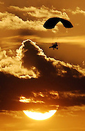 A powered parachute soars across the evening sky near Hutchinson, Kan. Friday, May 23, 2003. Nearly 30 powered parachute enthusiasts from across Kansas traveled to Hutchinson for the second annual Central Kansas Powered Parachute Fly-In.