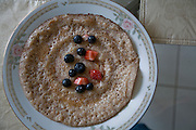 A breakfast pancake, similar to the injera flat bread eaten in Somalia, at the home of Somali student Muna al Ali, who lives in Scarboro, Ontario, Canada.