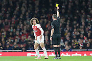 Arsenal midfielder Mattéo Guendouzi (29) is shown a yellow card, booked, during the EFL Cup 4th round match between Arsenal and Blackpool at the Emirates Stadium, London, England on 31 October 2018.
