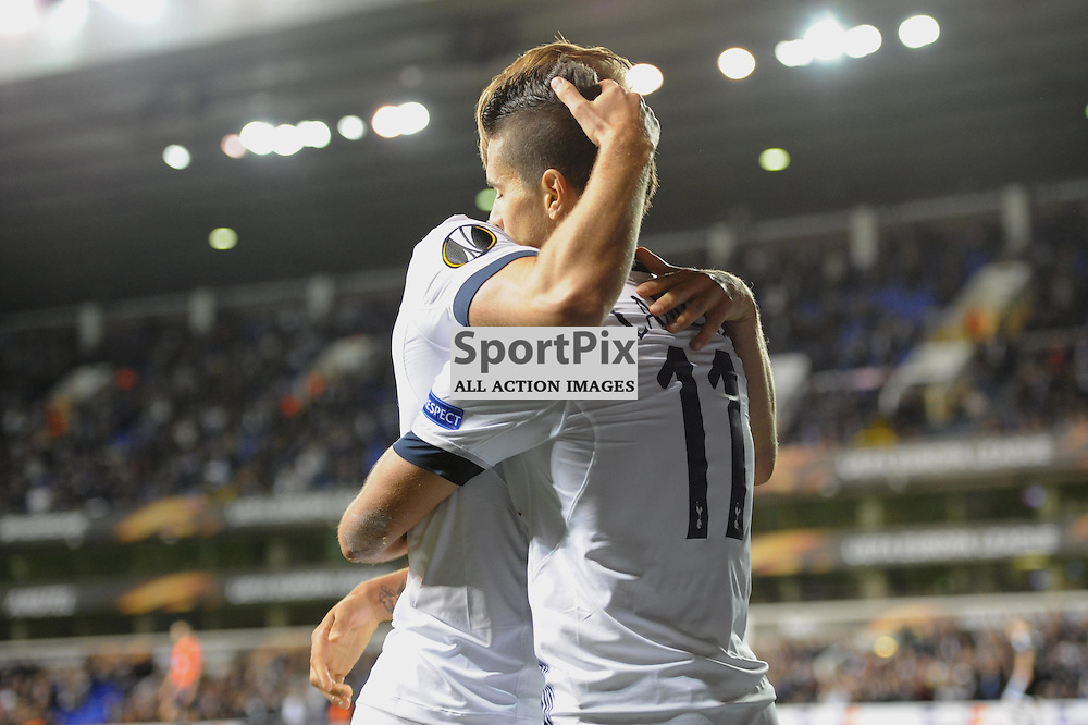 Tottenhams Erik Lamela celebrates scoring his sides third goal with Harry Kane during the Tottenham v Qarabag match in the Europa League group stage