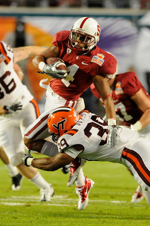 January 3, 2011: Drew Terrell of the Stanford Cardinal is tackled by Martin Scales of the Virginia Tech Hokies during the NCAA football game between the Stanford Cardinal and the Virginia Tech Hokies at the 2011 Orange Bowl in Miami Gardens, Florida. Stanford defeated Virginia Tech 40-12.