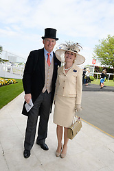 Trainer JOHN GOSDEN and his wife RACHEL at the Investec Derby 2013 held at Epsom Racecourse, Epsom, Surrey on 1st June 2013.