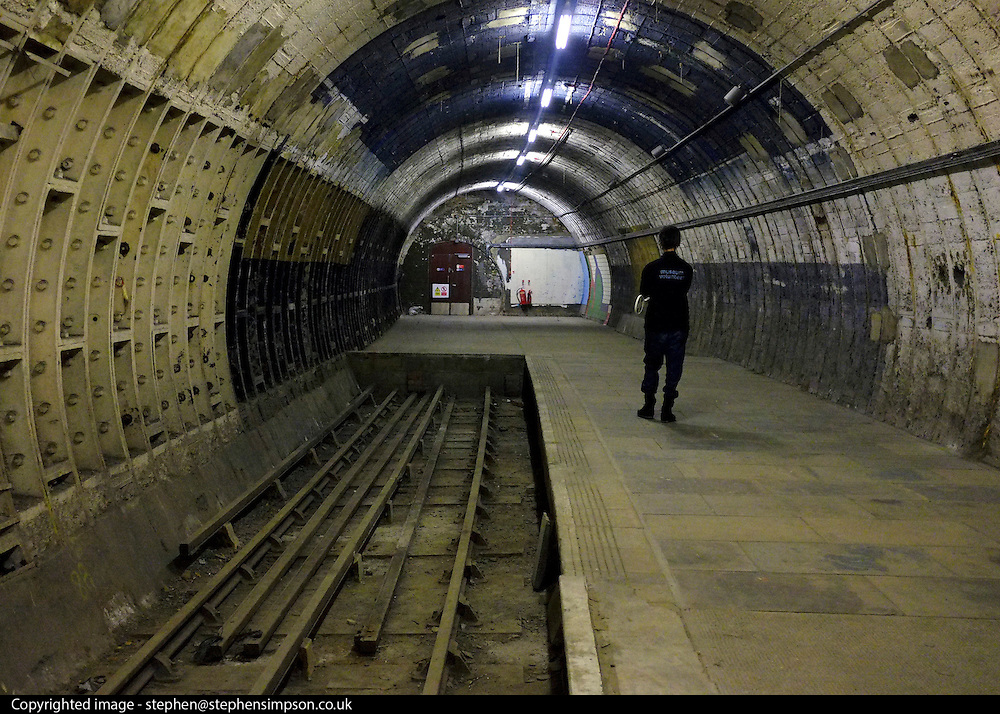 © Licensed to London News Pictures. 02/12/2012. London, UK The tracks were laid before the introduction of suicide pits common on tube lines today. London Transport Museum held tours, today 2nd December 2012, of Aldwych Tube Station, one of London's closed underground stations. Visitors were give a rare chance to glimpse what happens to a station after the public leave. The tour included a platform closed in 1914 which was used as a store for the National Gallery during the 2nd World War, amongst items stored were the Elgin Marbles. The station was used by 1000's of Londoners during the blitz as an air raid shelter. The station is often used for filming with films such as Atonement, V for Vendetta, Superman 4 and 28 weeks later. Photo credit : Stephen Simpson/LNP