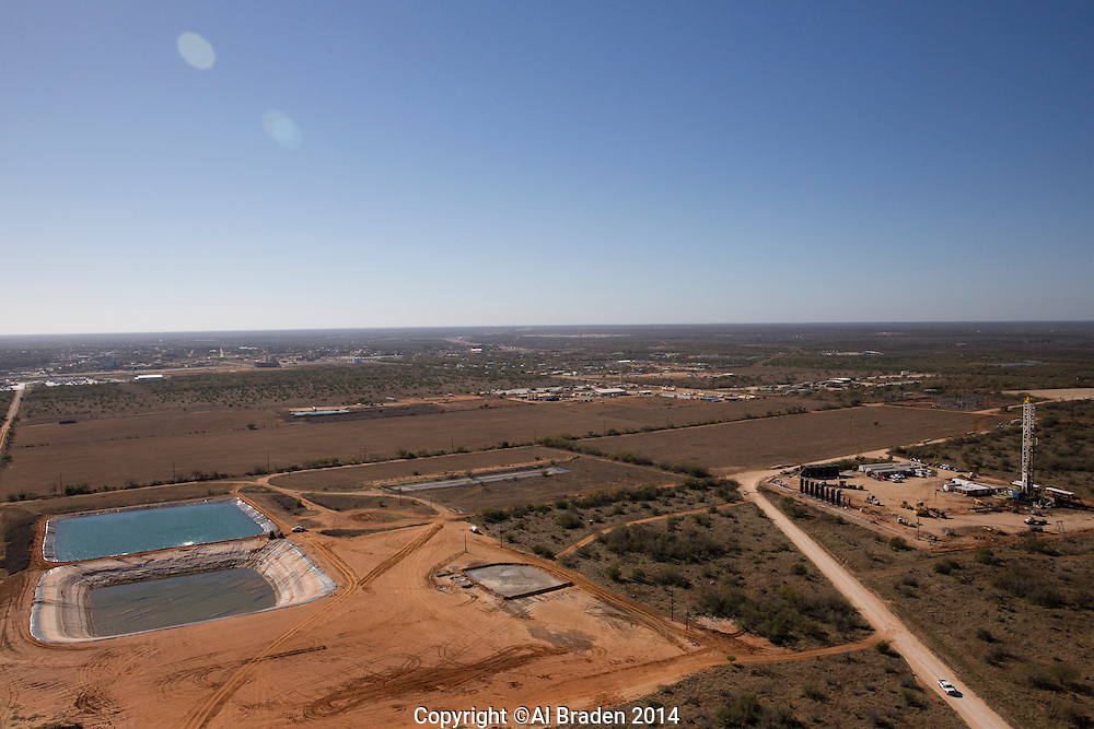 Oil drilling site, with drilling pond, Cotulla, TX