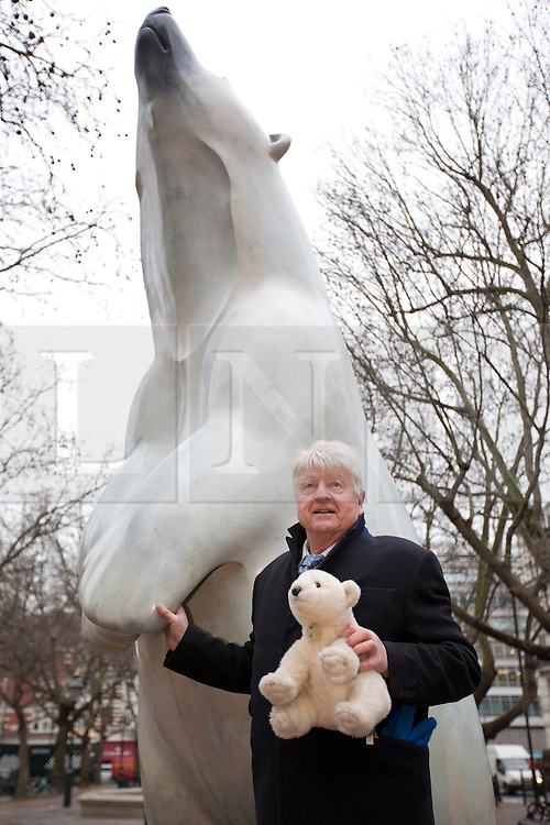© Licensed to London News Pictures. 14/01/2013. London, UK. Stanley Johnson, environmental campaigner and father of Boris Johnson, the mayor of London is seen next to a bronze polar bear statue called 'Boris' in Sloane Square in London today (14/01/12).  The sculpture by Adam Binder, 12 foot tall, weighing 700 kilograms, and on display for the next 28 days, was placed in Sloane Square to launch an urgent 28 day campaign calling for a ban on the killing of polar bears for their body parts.  Photo credit: Matt Cetti-Roberts/LNP