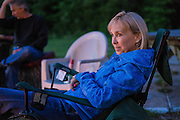 Kay Pratt relaxes after the first day of riding at the 2016 Hillbilly Dual Sport ride in Marble Falls, AR.
