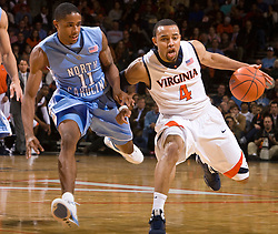 Virginia guard Calvin Baker (4) is guarded by North Carolina guard Larry Drew II (11).  The the #5 ranked North Carolina Tar Heels defeated the Virginia Cavaliers 83-61 in NCAA Basketball at the John Paul Jones Arena on the Grounds of the University of Virginia in Charlottesville, VA on January 15, 2009.