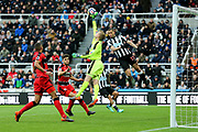 Jonas Lossl (#1) of Huddersfield Town gets a hand to the ball to deny Islam Slimani (#13) of Newcastle United a debut goal during the Premier League match between Newcastle United and Huddersfield Town at St. James's Park, Newcastle, England on 31 March 2018. Picture by Craig Doyle.