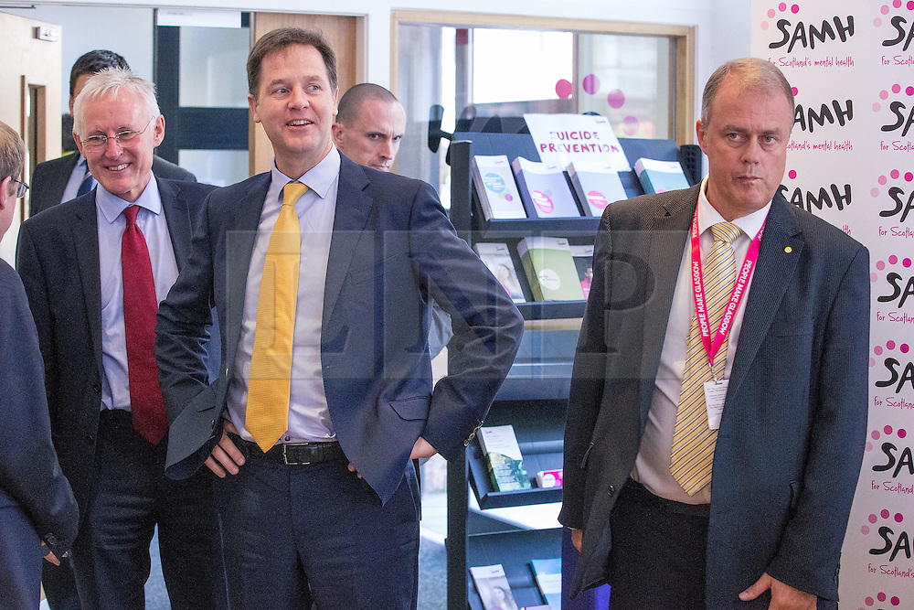 © Licensed to London News Pictures . 07/10/2014 . Glasgow , UK . EMBARGOED UNTIL 00:01 WEDNESDAY 08/10/2014 . Deputy Prime Minister NICK CLEGG (in yellow tie) visits the Scottish Association for Mental Health with Health Minister Norman Lamb to meet with staff and service users and discuss mental health issues . The Liberal Democrat Party Conference 2014 at the Scottish Exhibition and Conference Centre in Glasgow . Photo credit : Joel Goodman/LNP