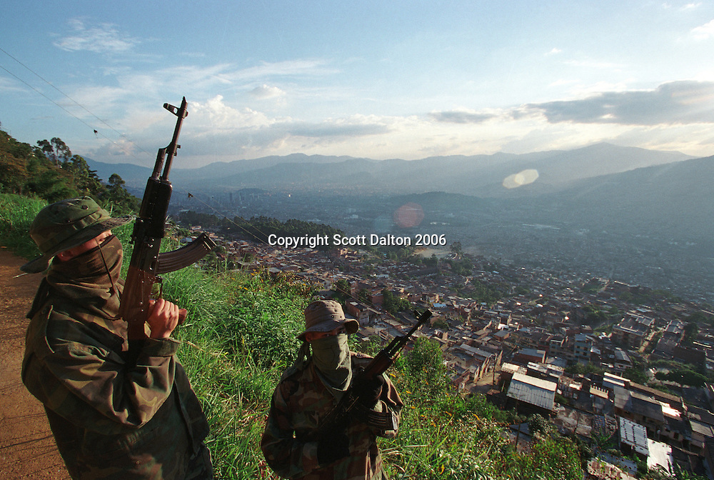 Paramilitary fighters patrol a barrio in Medellin. (Photot/Scott Dalton)