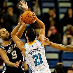 Jan 7, 2013; New Orleans, LA, USA; New Orleans Hornets point guard Greivis Vasquez (21) shoots over San Antonio Spurs point guard Tony Parker (9) during the first quarter of a game at the New Orleans Arena. Mandatory Credit: Derick E. Hingle-USA TODAY Sports